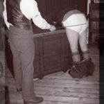 Image of teacher administering cor[poral punishment