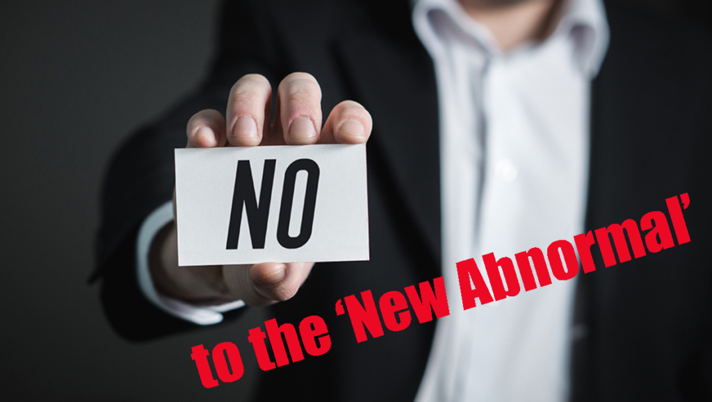 Image of the male half of hot bisexual escort couple holding sign saying No to the New Abnormal
